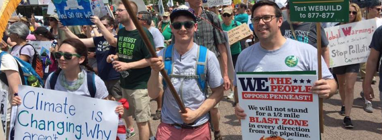 Seth Levin and Ed Potosnak march at the People's Climate March.